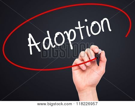 Man Hand Writing Adoption With Black Marker On Visual Screen