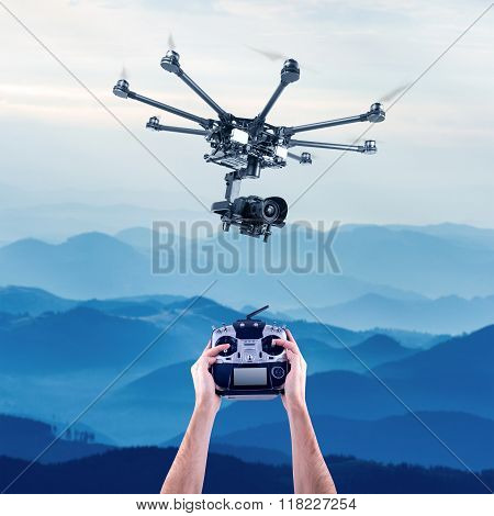 Man controls the flying drones