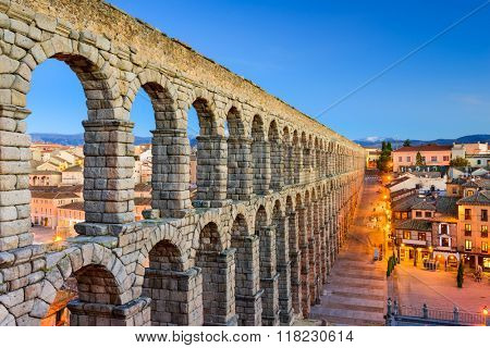 Segovia, Spain town view at Plaza del Azoguejo and the ancient Roman aqueduct.