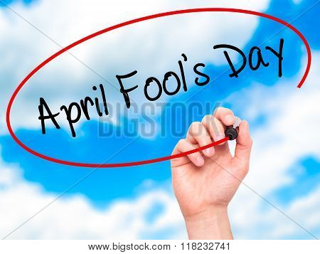 Man Hand Writing April Fool's Day With Black Marker On Visual Screen