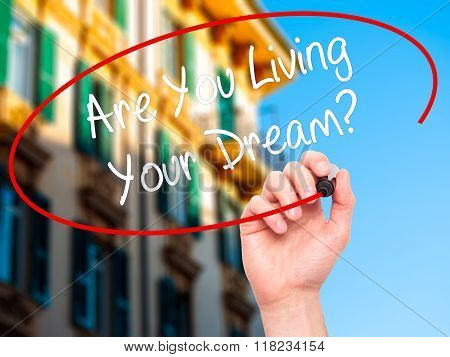 Man Hand Writing Are You Living Your Dream? With Black Marker On Visual Screen