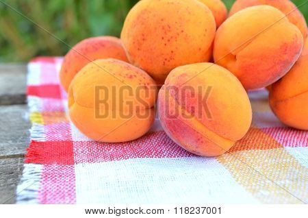 Fresh apricots on wooden table.