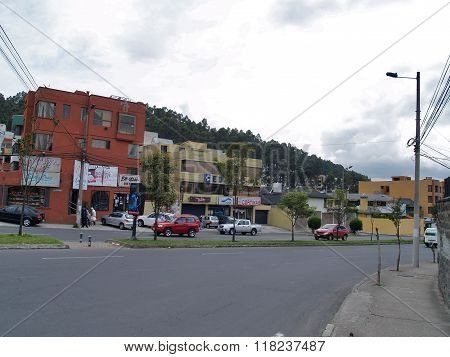Modern Buildings, People, Cars On The Streets Of The Capital City Of Quito