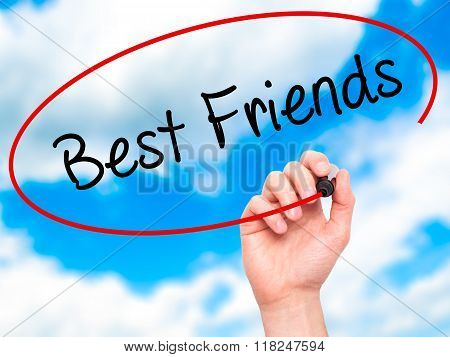Man Hand Writing Best Friends With Black Marker On Visual Screen