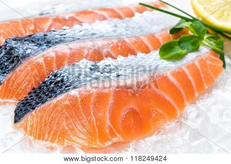 Fresh Sliced Salmon Portions On Ice.