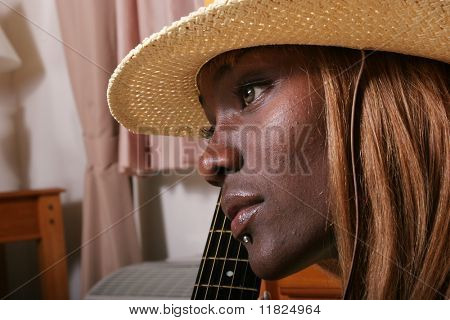 Attractive African American girl in hat