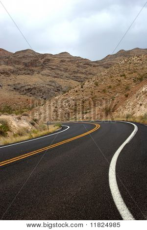 Road winding down along the mountains