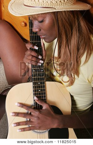 Attractive woman playing guitar