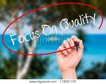 Man Hand Writing Focus On Quality With Black Marker On Visual Screen