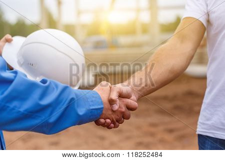 builders shaking hands
