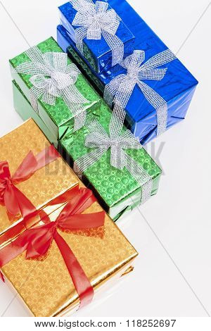 Celebration Concepts. Many Colorful Wrapped Up Gift Boxes Standing In Line Together. Against White.