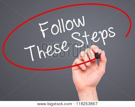 Man Hand Writing Follow These Steps With Black Marker On Visual Screen