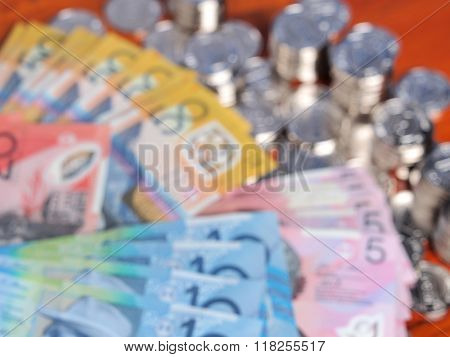 Out of focus blurry Background Of Australian Bank Notes And Silver Coins.