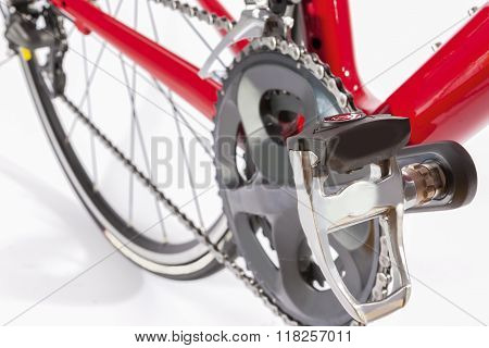 Cycling Concept. Crankset And Rear Cassette With New Chain. Against White.