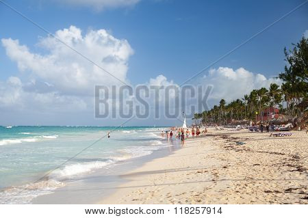 Tourists Walk Along A Beach Of Punta Cana Resort
