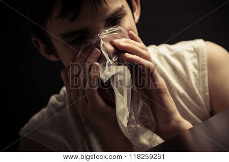 Teen Inhaling Narcotics From Plastic Bag