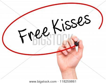 Man Hand Writing Free Kisses  With Black Marker On Visual Screen