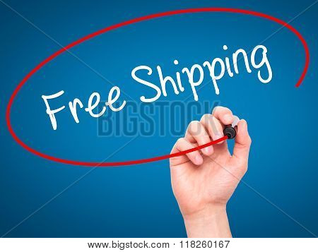 Man Hand Writing Free Shipping With Black Marker On Visual Screen