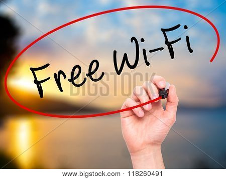 Man Hand Writing Free Wi-fi  With Black Marker On Visual Screen
