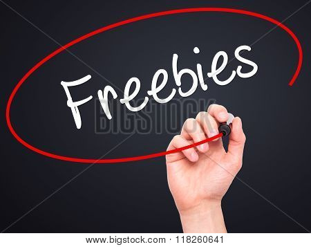 Man Hand Writing Freebies With Black Marker On Visual Screen