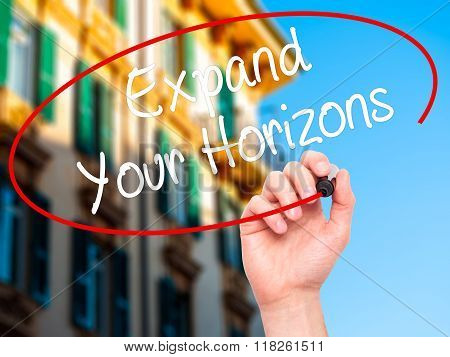 Man Hand Writing  Expand Your Horizons  With Black Marker On Visual Screen