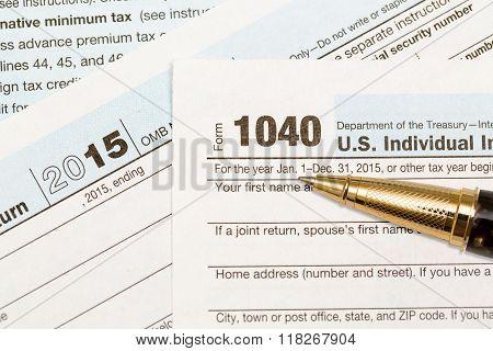 Gold Pen Laying On 2015 Irs Form 1040