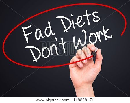 Man Hand Writing Fad Diets Don't Work With Black Marker On Visual Screen