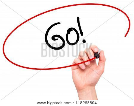 Man Hand Writing Go! With Black Marker On Visual Screen