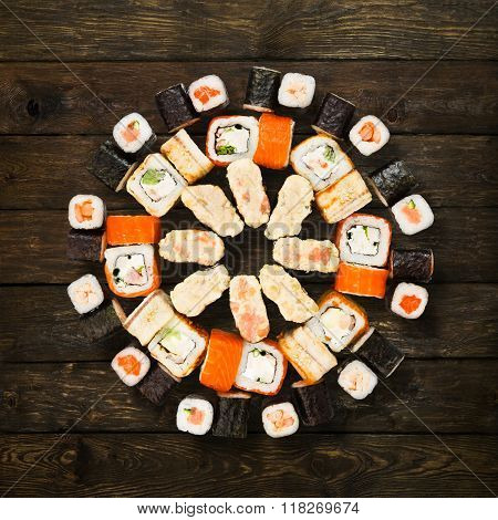 Set Of Sushi, Maki And Rolls Isolated At Wood
