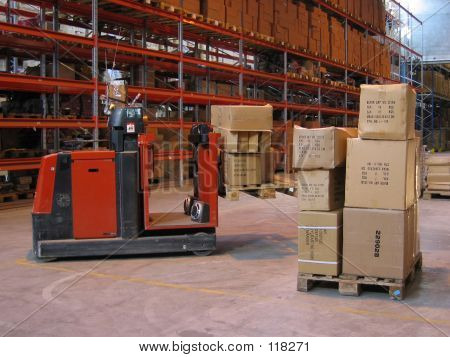 A Truck Lifting Pallet At A Warehouse