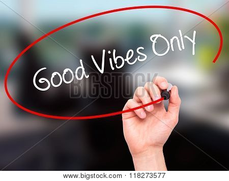 Man Hand Writing Good Vibes Only  With Black Marker On Visual Screen