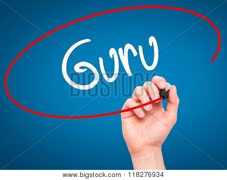 Man Hand Writing Guru With Black Marker On Visual Screen