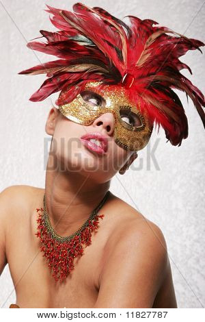 Gorgeous young biracial girl with red mask