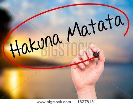 "Man Hand Writing Hakuna Matata (swahili Phrase; It Means ""no Worries"") With Black Marker O"