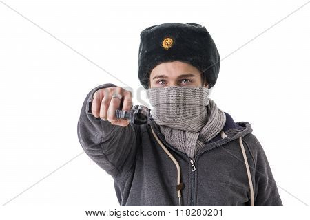 Man in winter hat and scarf threatening with gun