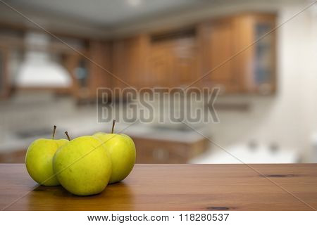 apples on old wooden table in the kitchen