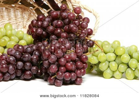 Red and green grapes in basket