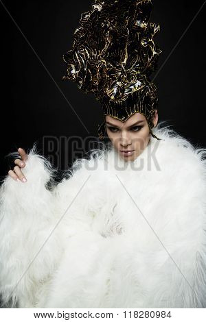 Woman in headwear and white fur coat