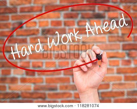 Man Hand Writing Hard Work Ahead With Black Marker On Visual Screen