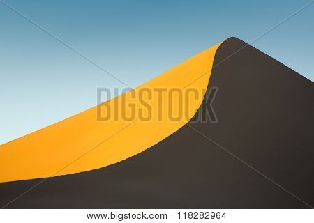 Untouched sand dune at sunset in Iran