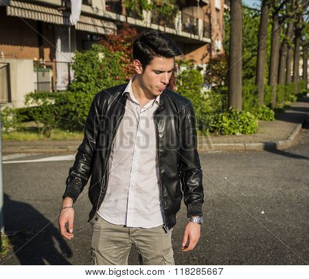 Young man spitting on the street