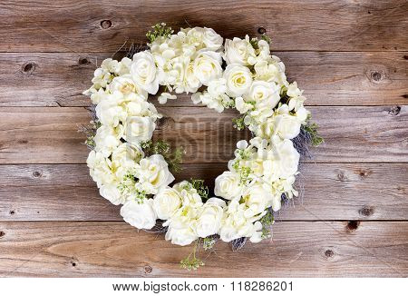 White Flowers Forming Wreath On Rustic Wooden Planks