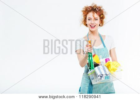 Housewife cleans with detergent spray isolated on a white background