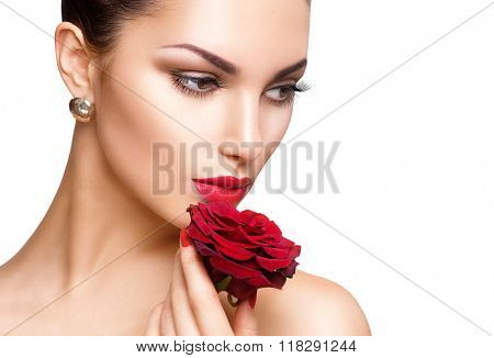 Beauty Woman with red rose. Fashion Model Girl face Portrait with Red Rose in her hand. Red Lips and Nails isolated on white background. Beautiful Luxury Makeup and Manicure. Vogue Style