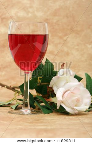 Red wine and white roses