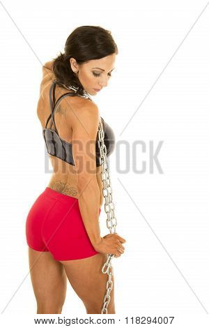 Woman In Sports Bra And Shorts Chain Around Neck Side