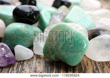 Semiprecious stones on wooden background