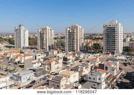 Contemporary residential buildings and houses in new neighborhood of Kiryat Gat - city in southern district of Israel.