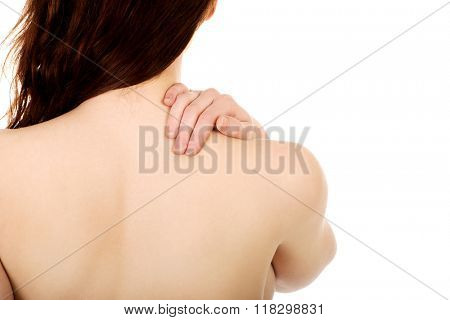 Woman holding her back.