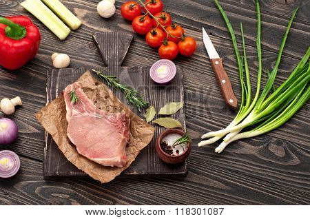 Piece Of Raw Juicy Meat With Vegetables